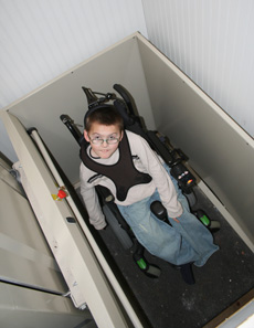 Wheelchair elevator