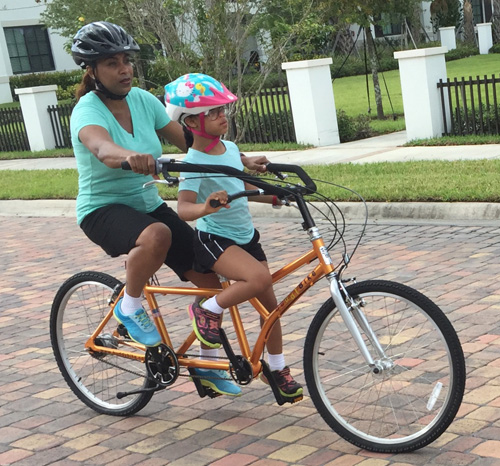 Mother and daughter ride Buddy Bike alternative tandem bike