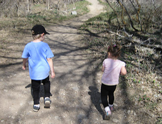 Children walking outside - preventing childhood obesity with healthy lifestyle and screening